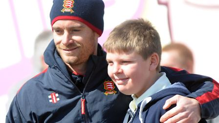 Matthew Hazell, 16, of the Essex Disability squad has his photograph taken with Essex captain James