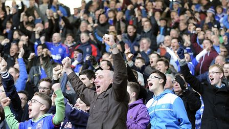 The travelling Town fans celebrate Carlos Edwards' late winner at Derby