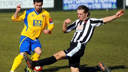 AFC Sudbury's Robbie Martin, left, takes on his his former team-mate Rhys Darg, who is now with Heyb