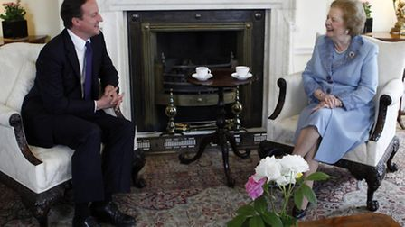 Prime Minister David Cameron speaking with former Prime Minister Baroness Thatcher inside 10 Downing