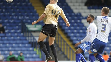 Josh Thompson heads in Colchester's equaliser at Bury