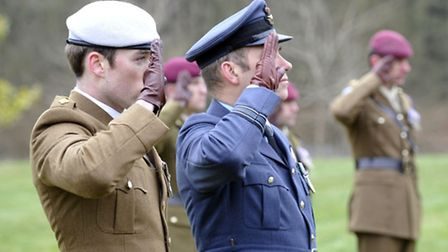 Operation Varsity service of remembrance, Marks Hall Estate, Essex. Servicemen salute during the min