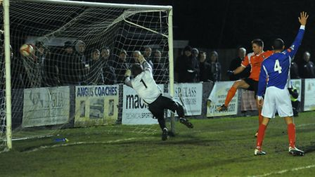 Bury Town 's John Sands smashes the ball home from close range to equalise against Leiston in the Jo