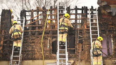 Fire crews attend the scene of a thatched house fire in The Street, Heveningham.