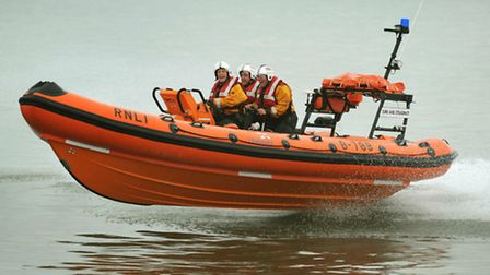 A man who was thrown into the cold sea water after crashing into the pier was rescued by lifeguards.