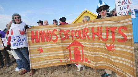 Angry beach hut owners take part in a protest march on Felixstowe promenande.