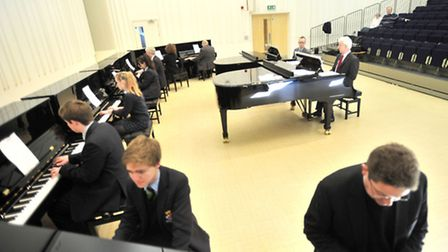 Ten pianists from the Royal Hospital School, Holbrook, perform the world premiere of a piece of musi