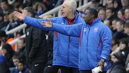 Terry Connor and Mick McCarthy direct their players at Peterborough