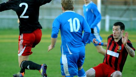 Brightlingsea Regent, red and black stripes, pictured playing against Brantham Athletic in the FA V
