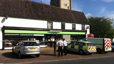 Police at the scene of a robbery at the Co-op in Laxfield
