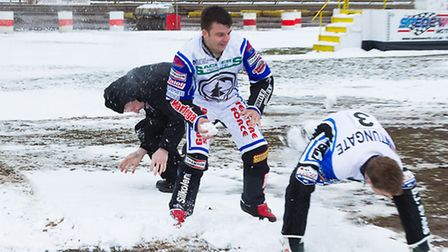 Witches team manager Pete Simmons is hit by a snowball as Ben Barker and Rohan Tungate get involved