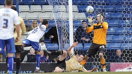 U's keeper Sam Walker makes another reaction save during the second half at Bury in the U's last out