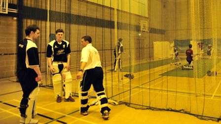 New player-coach Simon Guy, front right, giving advice to Tom Rash, left, and Sasha Ward, centre, at
