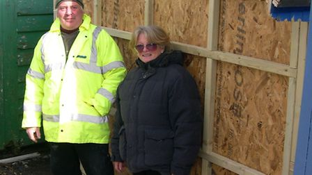 Alan Sarfas and Barbara Grace with the work they have done to shorten their beach hut at The Dip, Fe