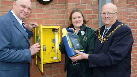 The East of England Co-operative Society installs defibrillator at West Mersea in Essex, one of 100