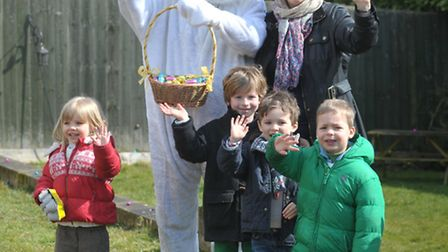 Polly Durrant with some of the children at the Easter egg hunt at the Ufford Crown.