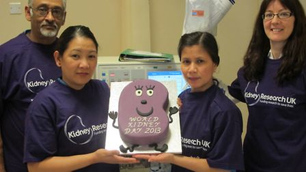 Colchester Dialysis Centre with the cake are (left to right): Tony Patel, dialysis assistant; Grace