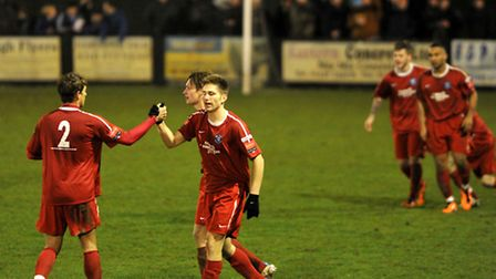 Bury Town players celebrate after John Sands, centre, scored against Leiston in last season's semi-f
