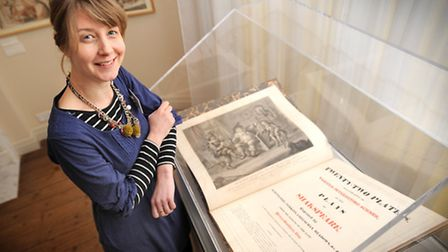 Curator Sophie Woods with the Shakespeare playbook illiustrated by Henry Bunbury.