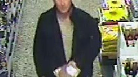 CCTV image of man wanted in connection with the theft from a shop