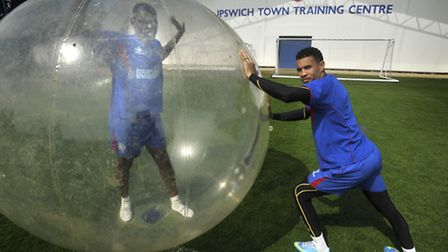 FAMILY DAY: Ipswich Town player Jay Emanuel-Thomas inside a zorb ball, with team mate Carlos Edwards