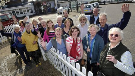 Local Councillors and residents celebrate the news that Woodbridge Train Station now has a ticket ma