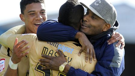 Clinton Morrison gives Gavin Massey a big hug at Brunton Park after the U's secured their League One