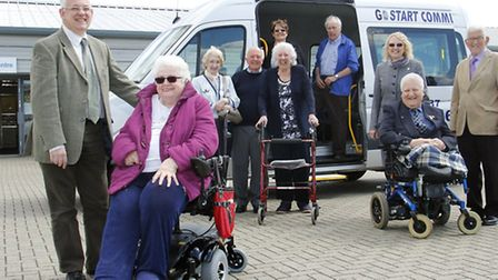 Graham Pendlebury chats to passenger Pat Moody, and members of the Suffolk Community Transport group