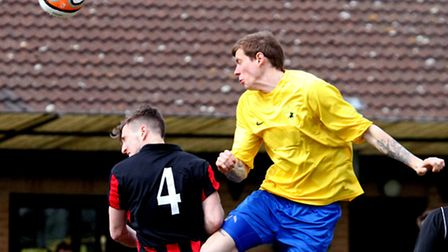 Newmarket Town's Luke Butcher, right, wins this aerial challenge with Matt Snelling of Brightlingsea