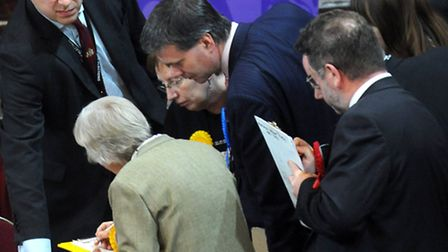 Party agents and candidates examine results during the county council elections. Will a fractured op