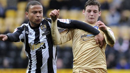 Drey Wright tussles with Curtis Thompson