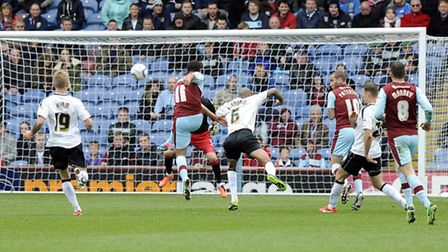 BOLT FROM THE BLUE: Burnley substitute Junior Stanislas fires home Burnley's opener against Ipswich