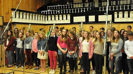 Fifty students from Woodbridge School spent a day at a recording studio to sing their part of a char