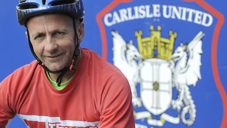 Colchester Chairman Robbie Cowling at the end of his charity bike ride to the final match of the sea