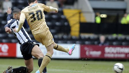 Drey Wright fires a first half shot at Notts County