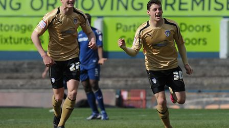 Drey Wright celebrates scoring at Oldham, with Michael Smith joining in the celebrations