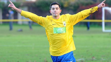 Newmarket Town's Aaron Turner celebrates a goal earlier this season. Newmarket are now celebrating p