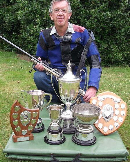 Bill Bond, of Felixstowe Rifle Club, with some of his shooting trophies.