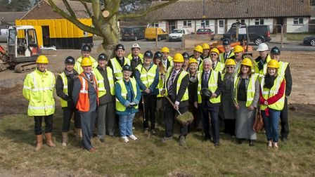 Suffolk Coastal chairman Richard Kerry turns the turf to start the work on 14 new afforable homes at