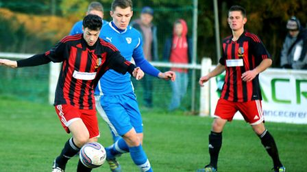 Brightlingsea Regent (red and black stripes) pictured playing host to Brantham Athletic in the Third