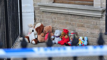 Cuddly toys left at the house in Lowestoft where three children were found dead.