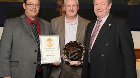 Chris Burrows and Graham Pentelow collecting their award from Keith Fisher of BPEX at the BPEX 'Foo