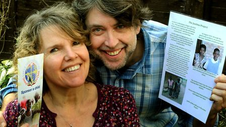 Alan and Jane with information on their Justina Project initiative and the World Shine Foundation ch