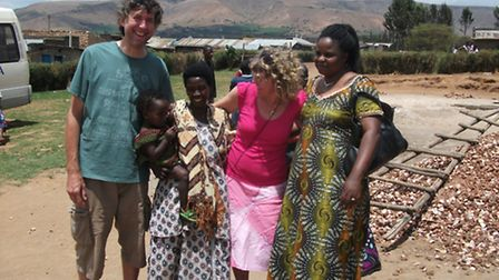 Jane and Alan Hutt, who have left their Rendlesham homes to go and work in Uganda, with Justina and