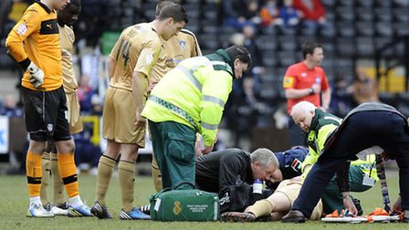 An unconsious David Wright is tended to by medical staff at Notts County. He is set to return to the