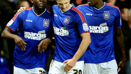 Frank Nouble, left, celebrates his goal with Tommy Smith and Jay Emmanuel-Thomas, right