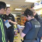 Home Office Immigration Enforcement officers question a suspected illegal worker in Ipswich.