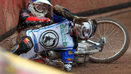 James Sarjeant crashes into a fallen Adam Ellis in the rerun of heat 2 at Leicester yesterday. Photo