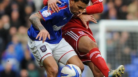 Carlos Edwards defends the ball from Kieran Dyer.