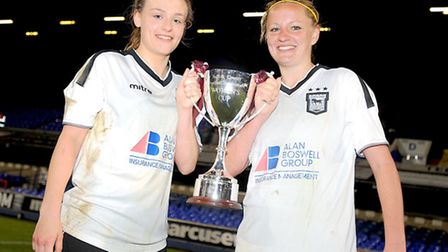 Ipswich Town's Lauren Cartwright, left, and Rosi Webb celebrate with the Suffolk FA Women's Cup afte